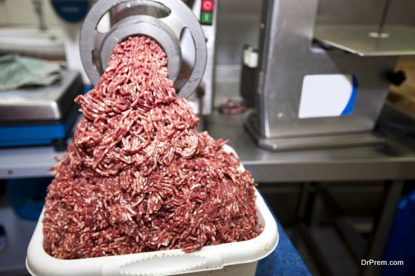 Machine mincing meat in grocery store