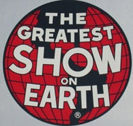 "Vintage sign that reads ""Greatest Show on Earth,"" symbolizes Barnum & Bailey & Bitcoin"