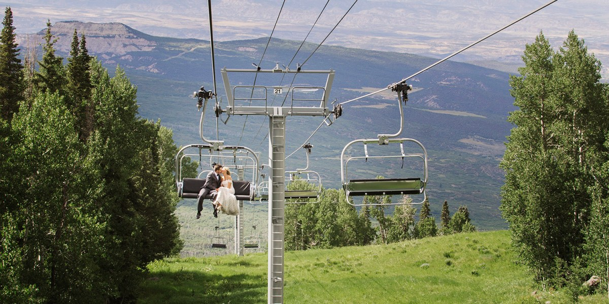 Bride & Groom on ski lift | Powderhorn Ski Resort Wedding Photographer