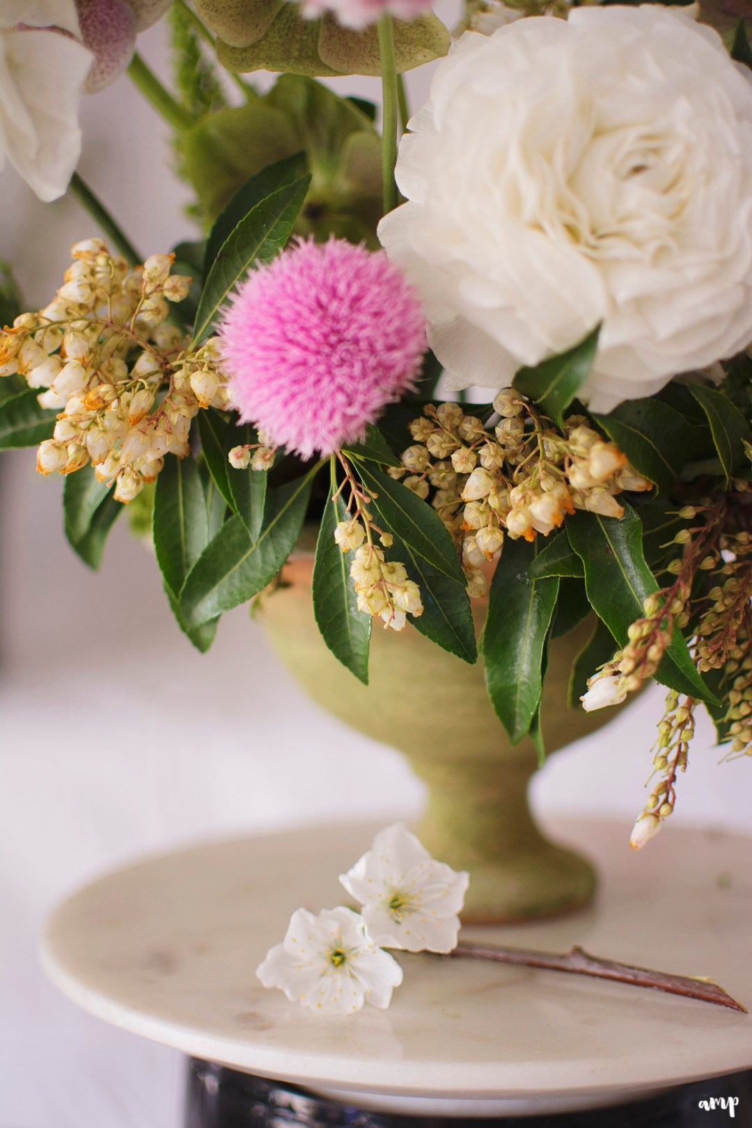 Close up of centerpiece with white and pink florals
