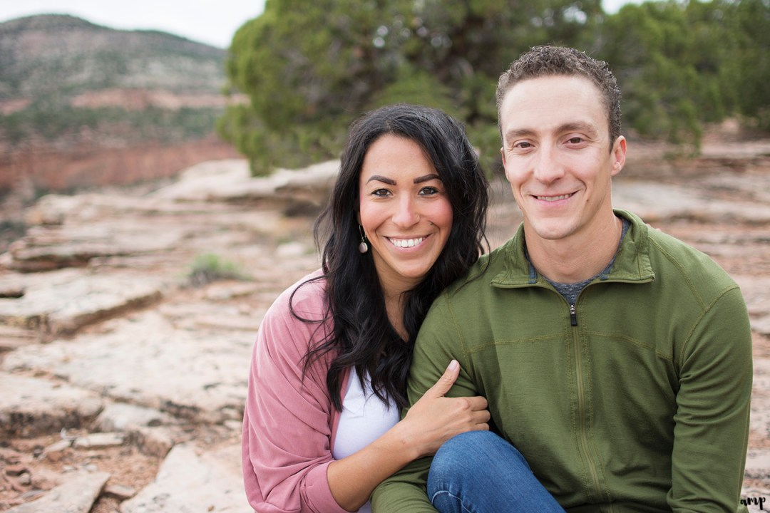 Couple sitting in the desert of the Colorado National Monument