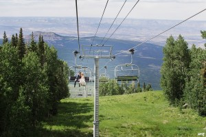 Bride and groom riding the ski lift at their destination wedding