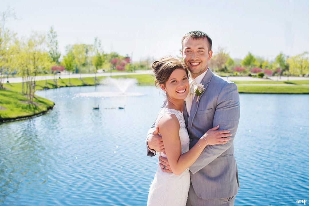 Bride & groom beside pond