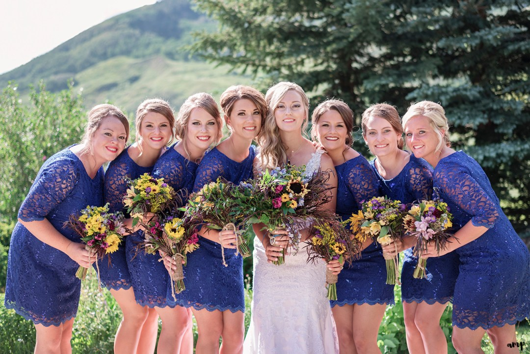Bridesmaids and their wildflower bouquets in the garden
