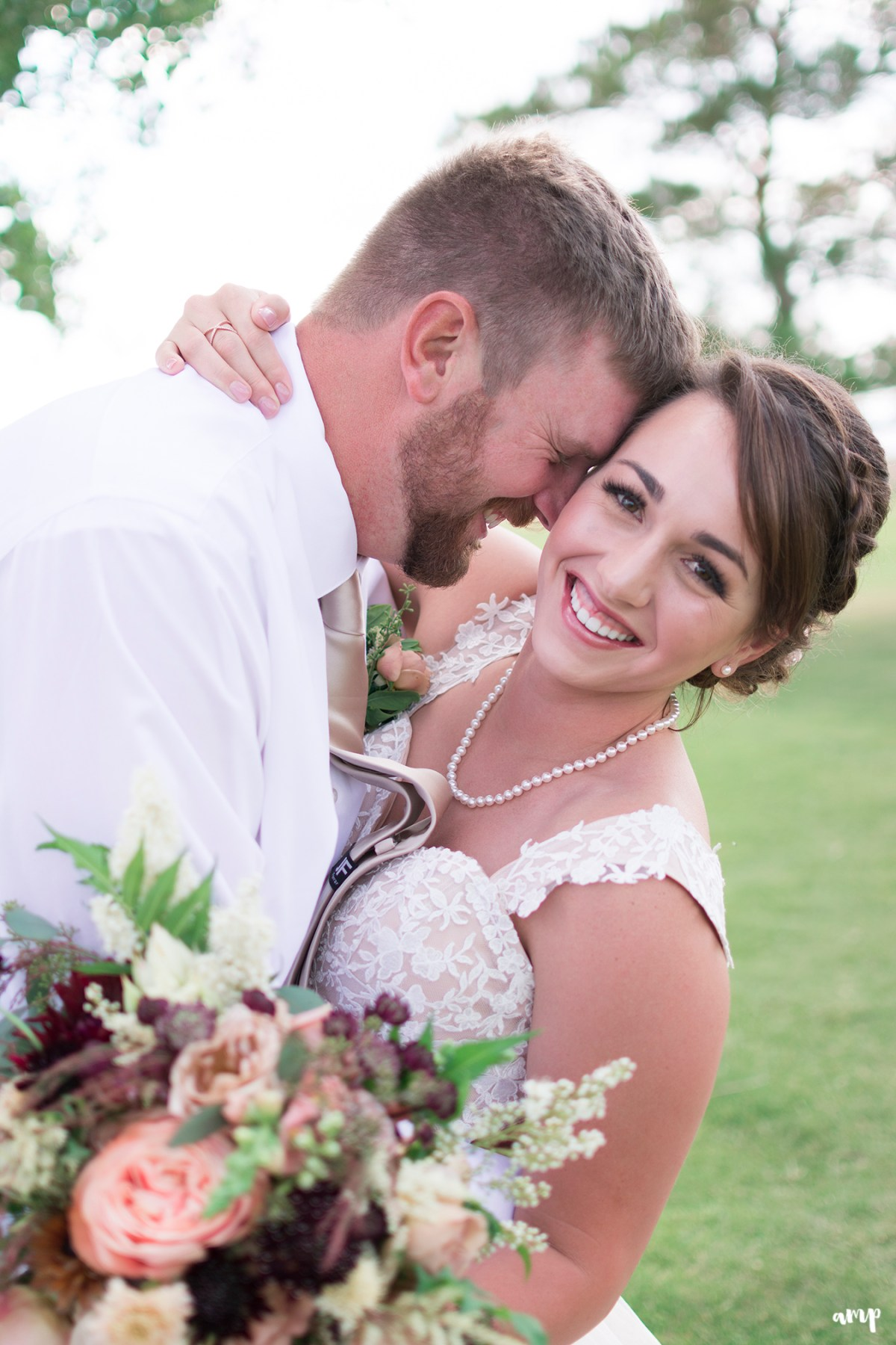 Whimsical vintage flower bouquet and bride with groom laughing