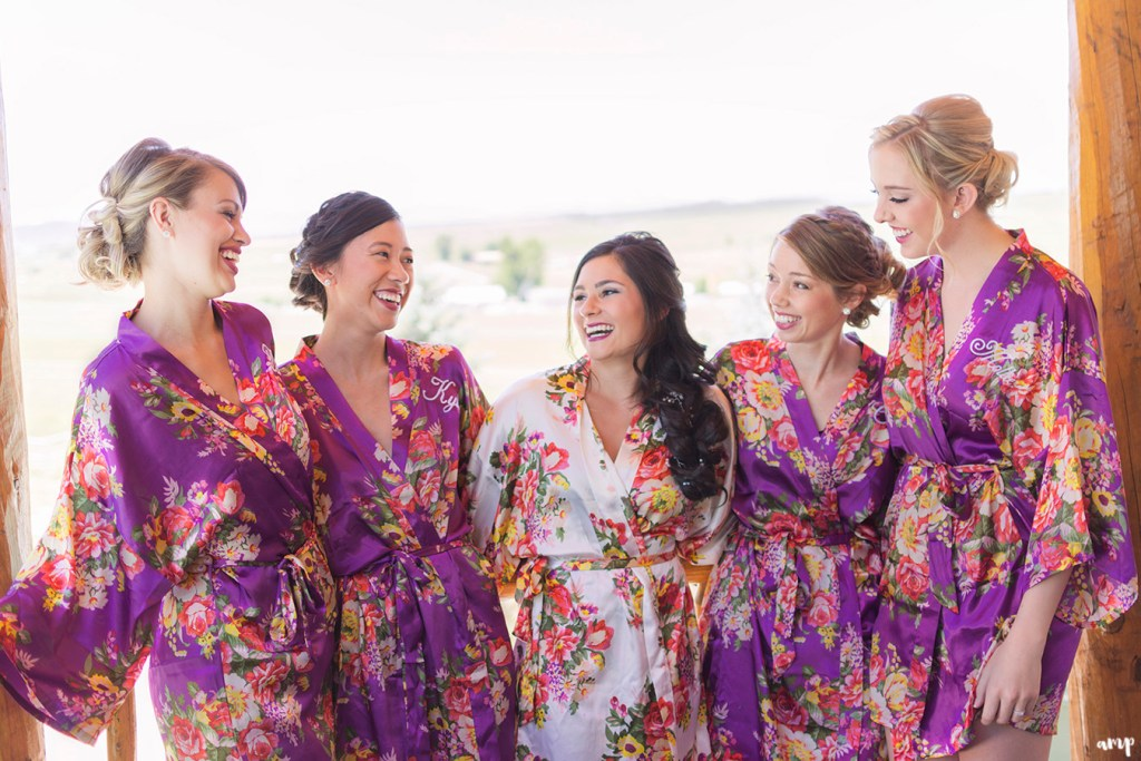 Bride and her bridesmaids in matching robes getting ready for the wedding