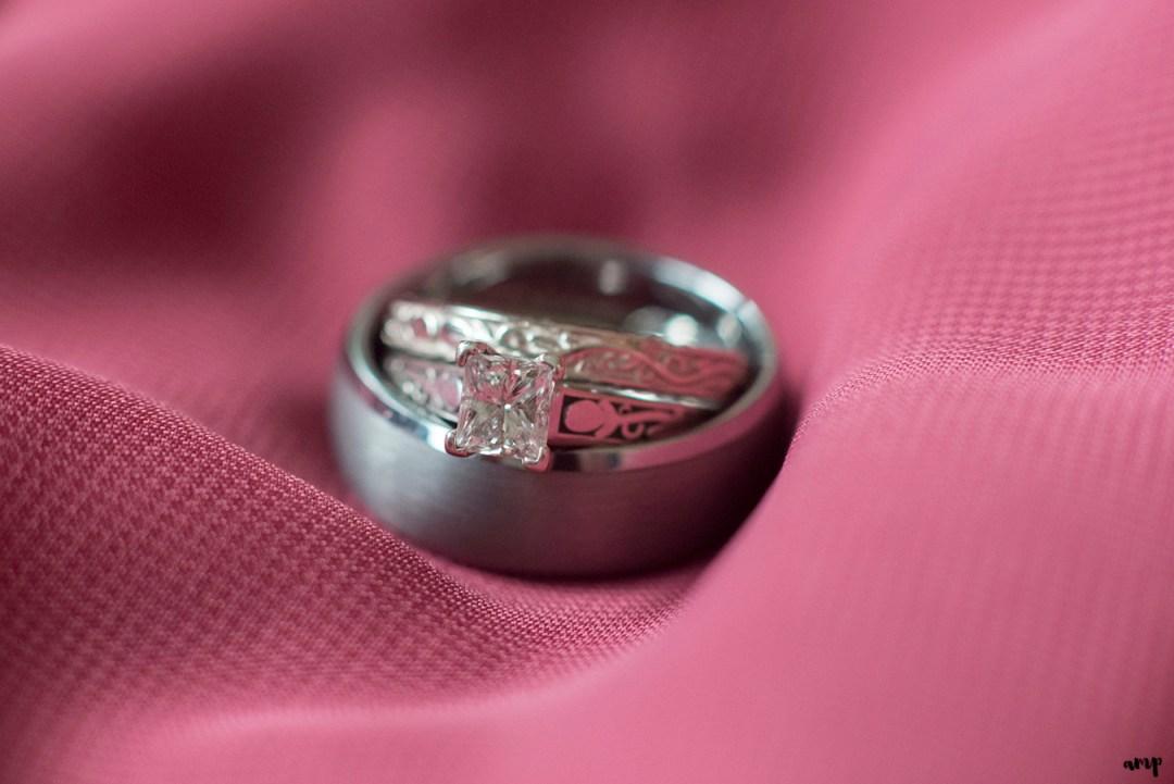 Wedding ring detail shot on magenta bridesmaids dress