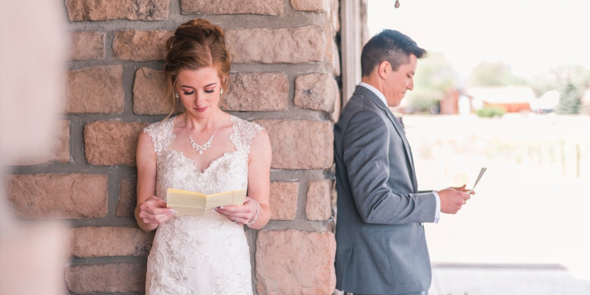 Bride and groom exchanging love letters | amanda.matilda.photography