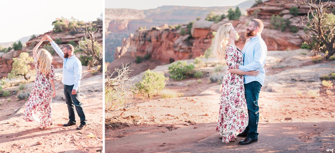 Soft glow of the desert as engaged couple dance at sunset