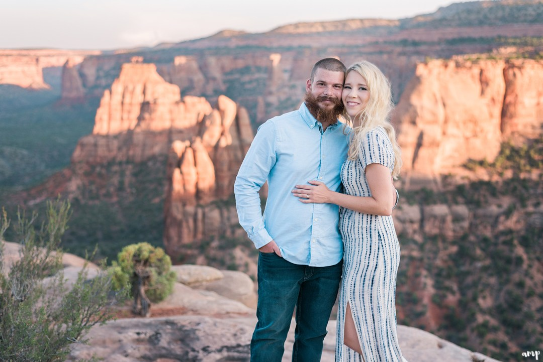 Engaged Couple posing in front of Independence Monument, Grand Junction