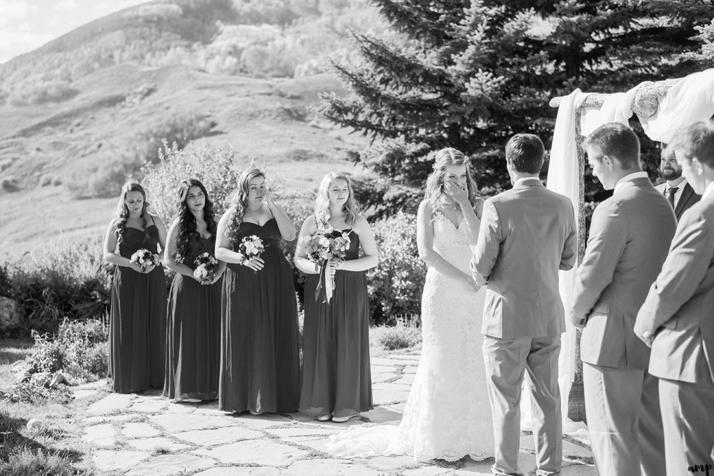 Bride cries during their wedding ceremony at the Mountain Wedding Garden in Crested Butte