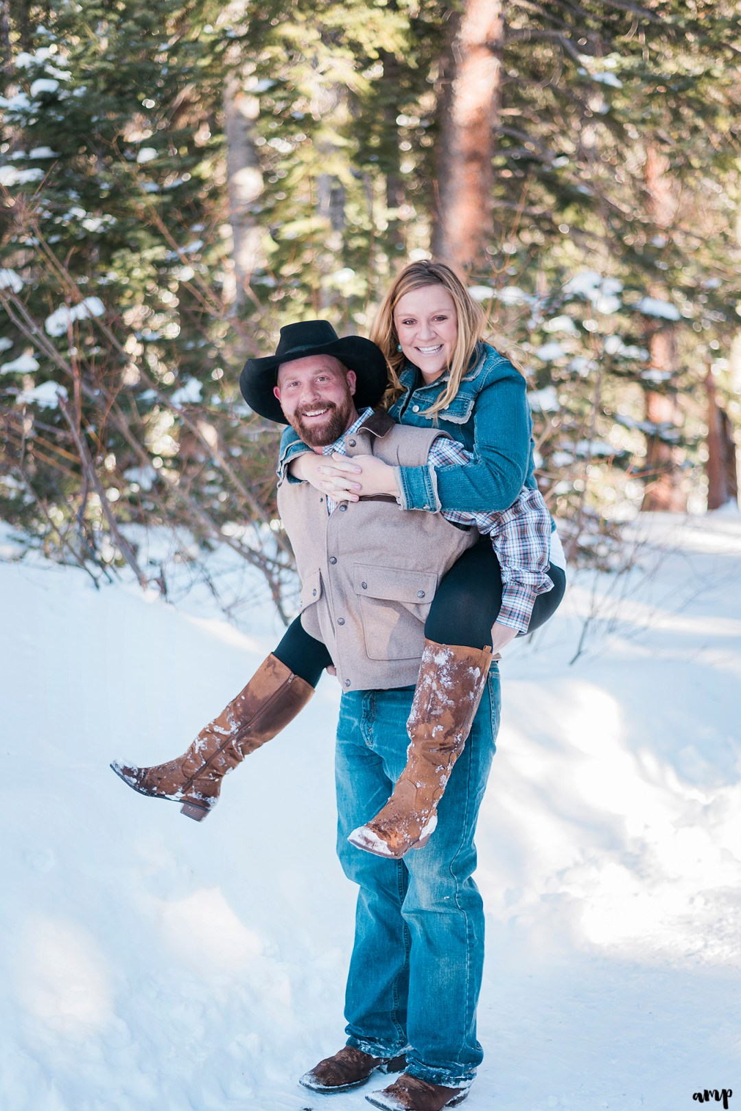Engaged couple giving a piggy back ride on the grand mesa