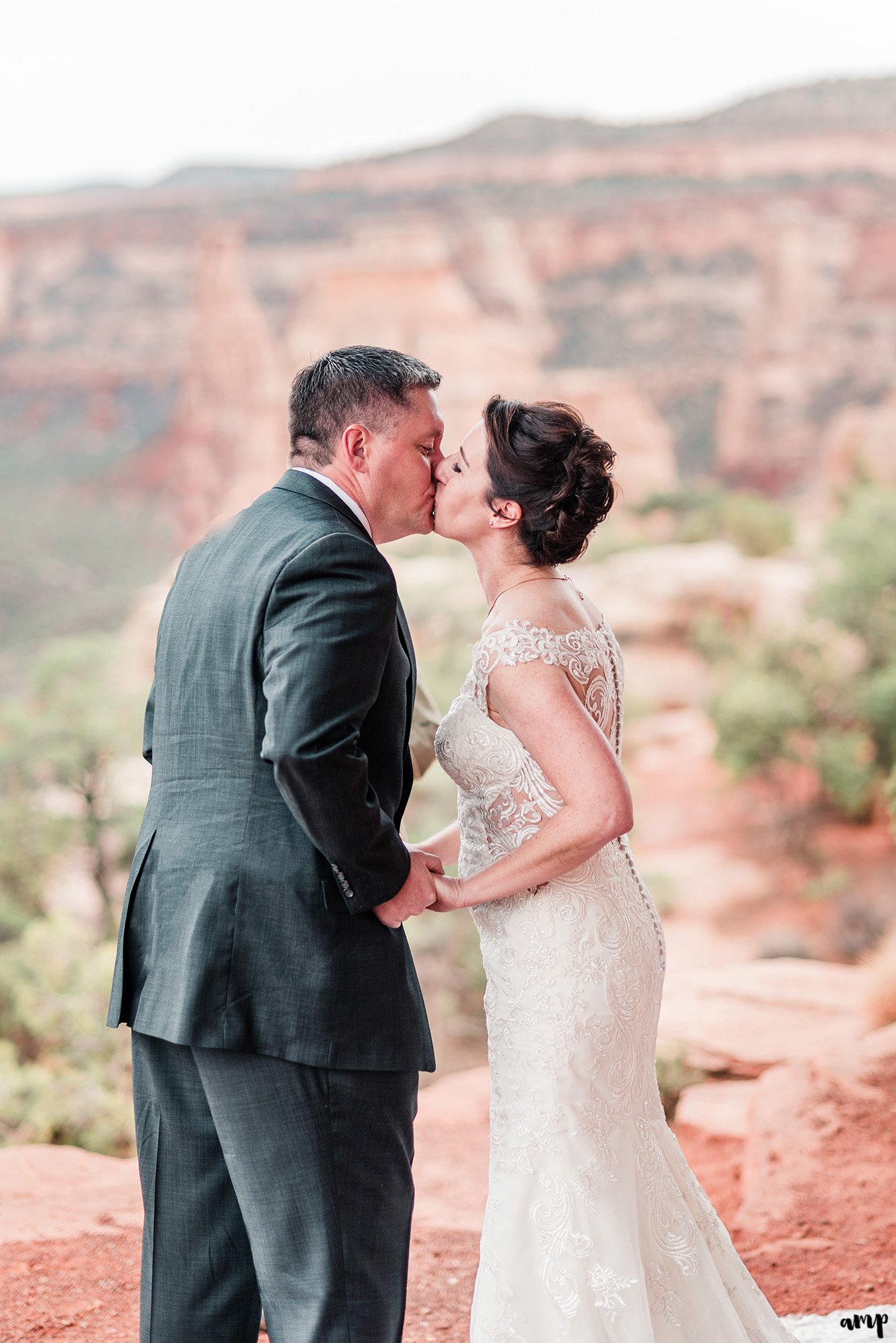 Newlyweds share their first kiss on the national monument in Grand Junction