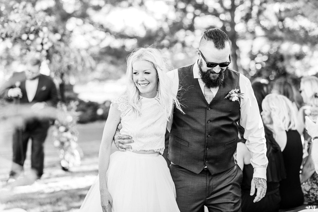 Beth and Dustin walking out of ceremony arm-in-arm | Grand Junction Backyard Wedding | amanda.matilda.photography