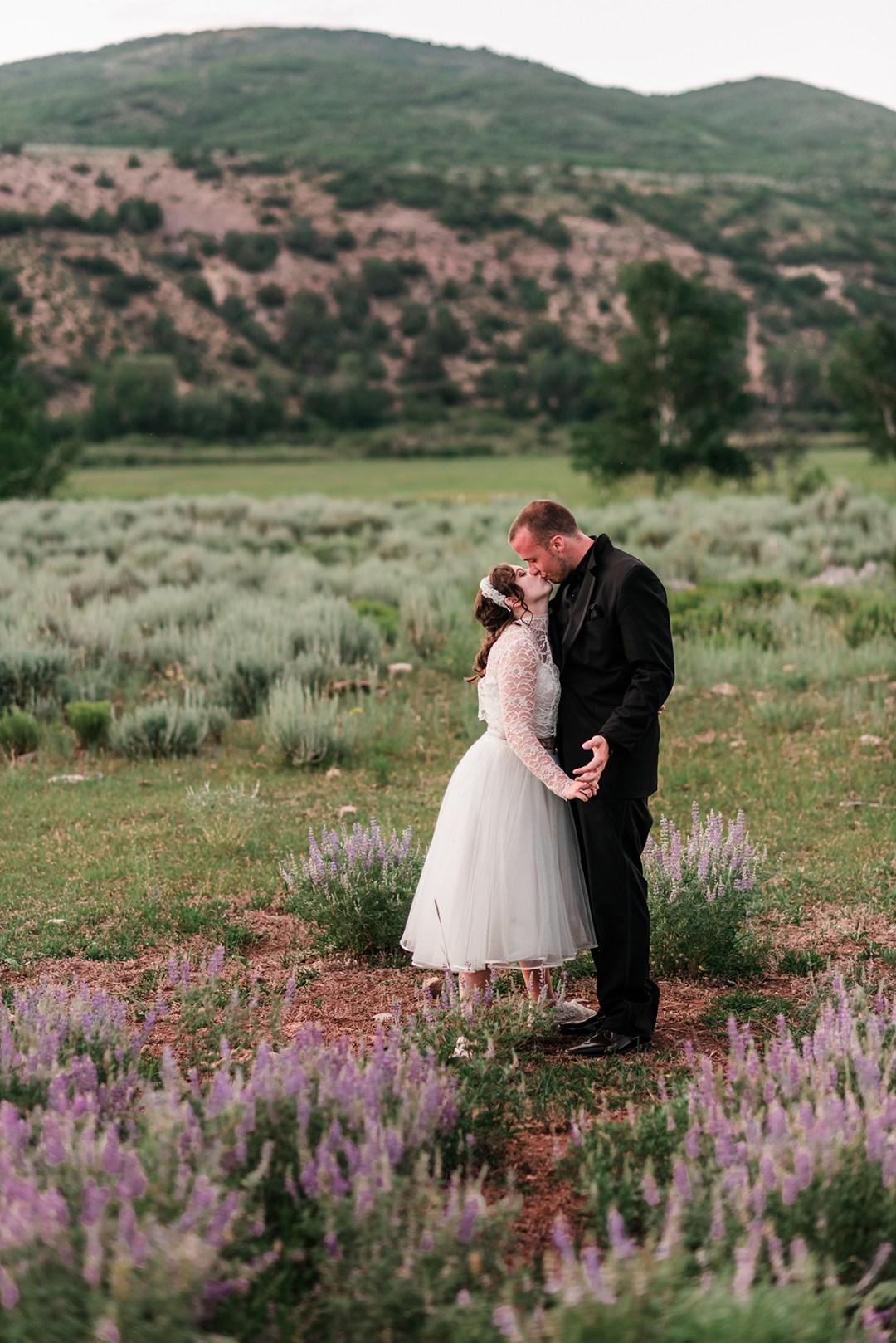 Josh & Annie in a field of purple lupine at Rolling R Ranch near Meeker