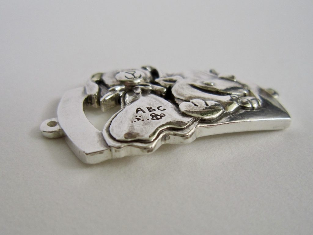 Side view of silver bracelet charm