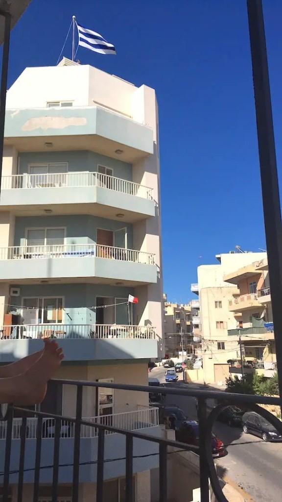 Buildings in Bugibba Malta against a blue sky