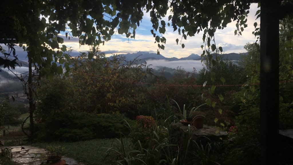 Asturias Spain view of the garden and mountains beyond