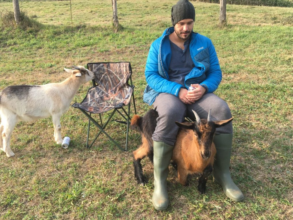 Jonathan Clarkin and two goats hanging out in Spain
