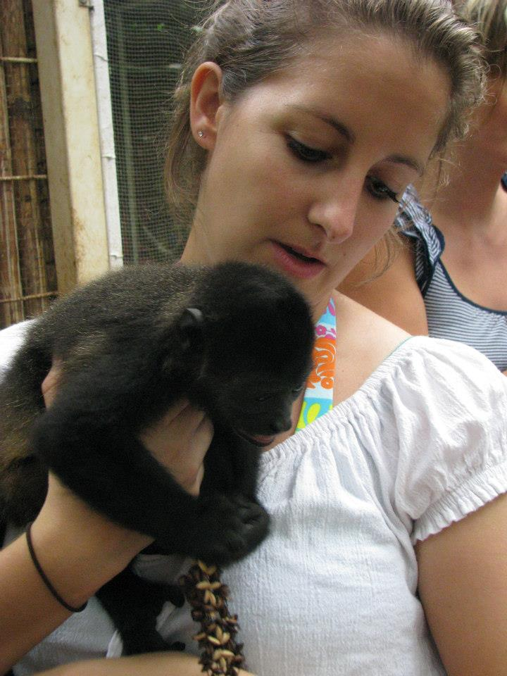 Amanda Walkins holding a baby monkey in a rescue center in Costa Rica