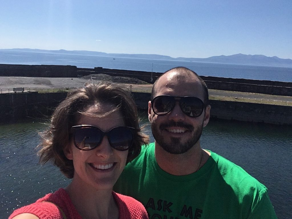 Amanda Walkins and Jonathan Clarkin on a bright sunny day taking the CalMac ferry to Arran in Scotland