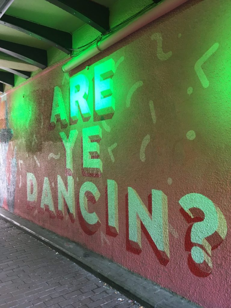 Street art says Are ye Dancin at Sloans bar in Glasgow