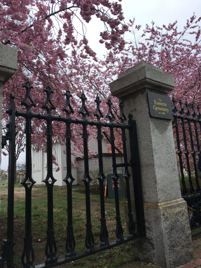 Gate to Eastern Cemetery with a small plaque - Portland Maine walking tour