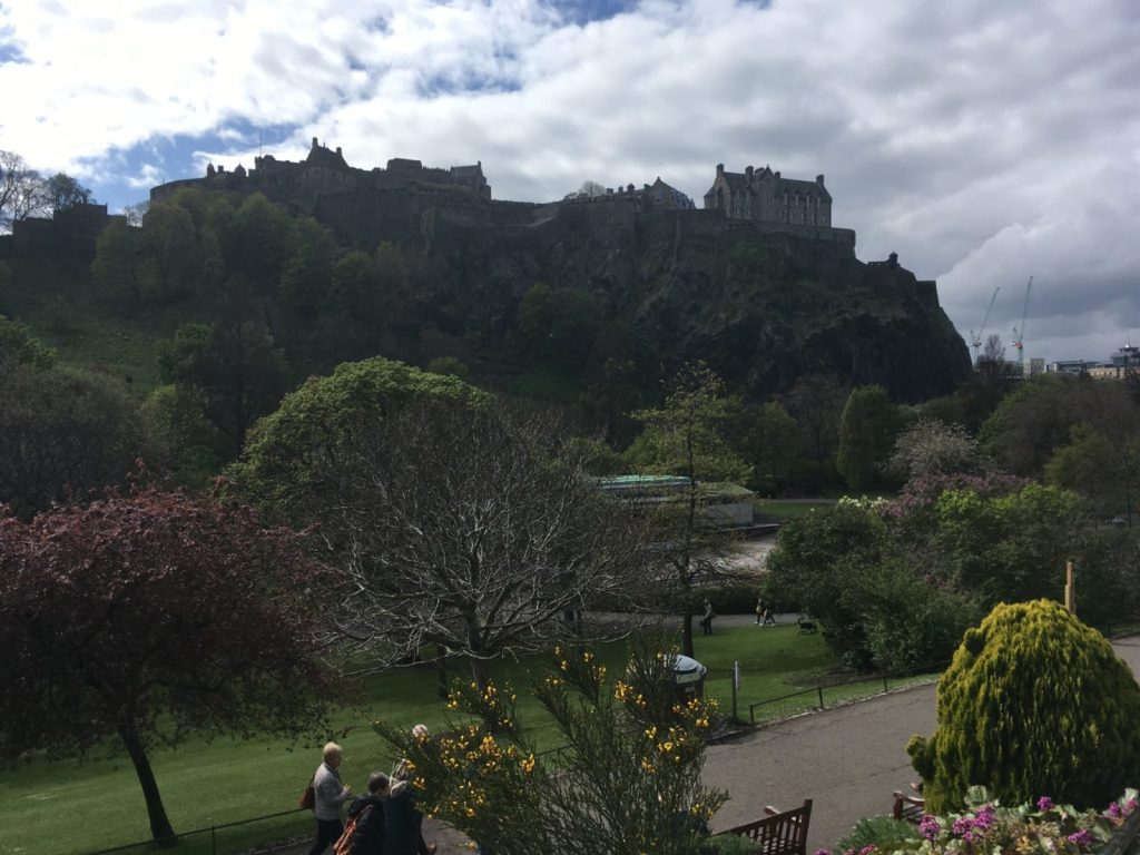 Edinburgh Castle in Scotland with lush gardens below