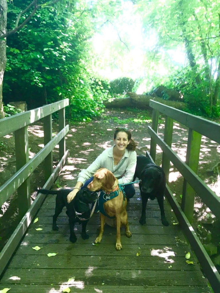 Amanda Walkins with 3 dogs on a wooded path in Edinburgh