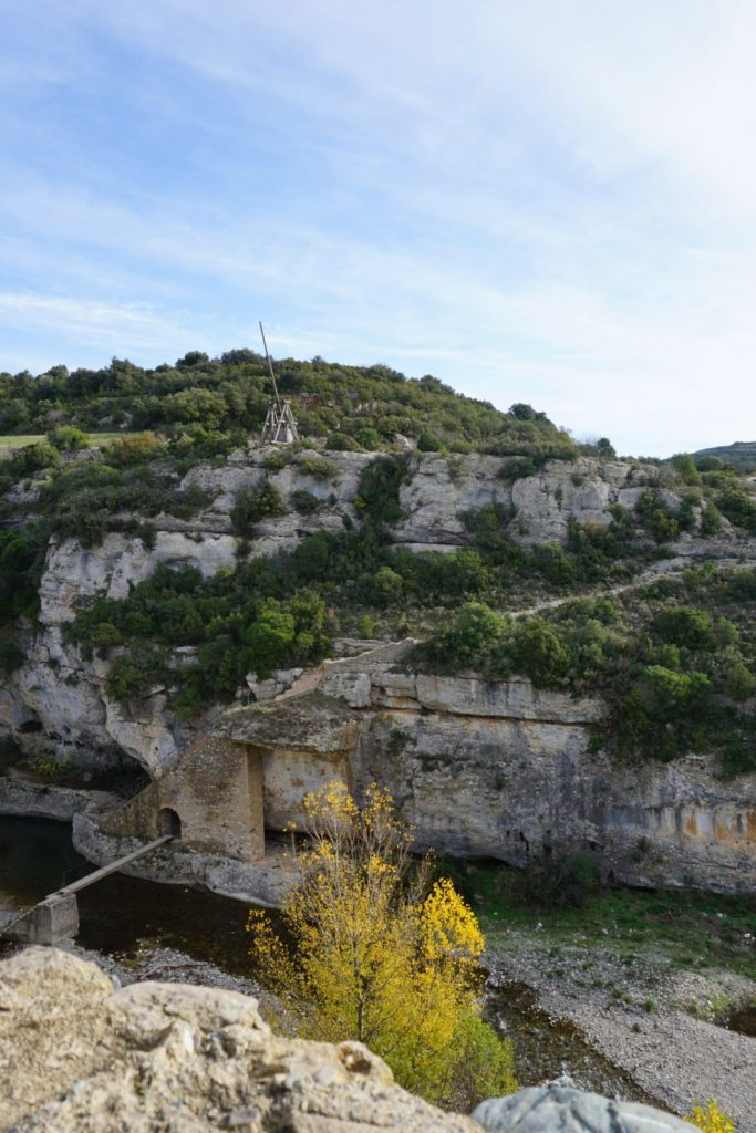a wooden catapult stands across a gorge outside of Minerve in France