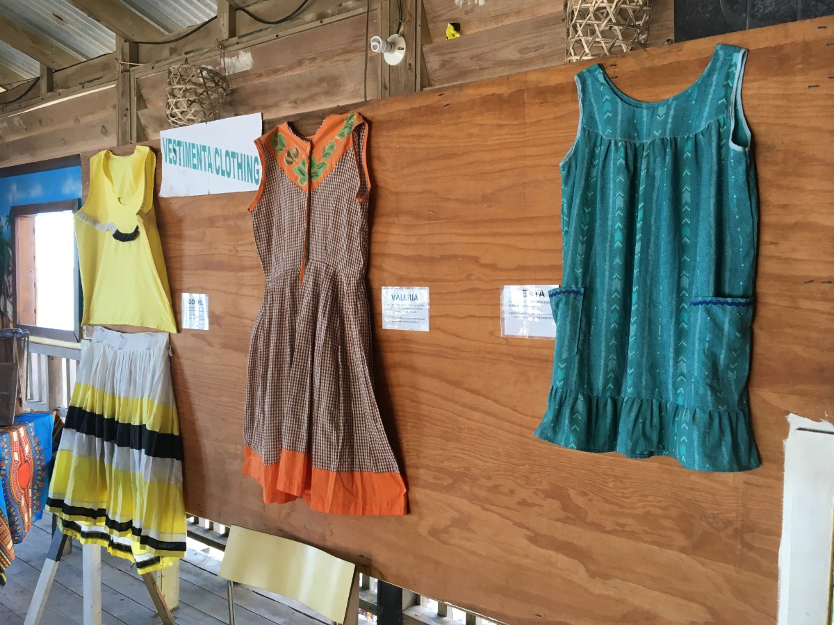 Garifuna clothing hanging on a wall to teach visitors to the Flamingo Cultural Centerin Roatan