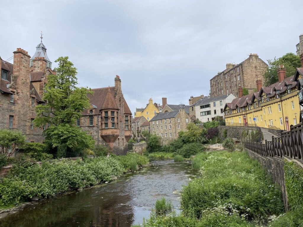 Dean Village in Edinburgh with colorful buildings lining the small riverbanks