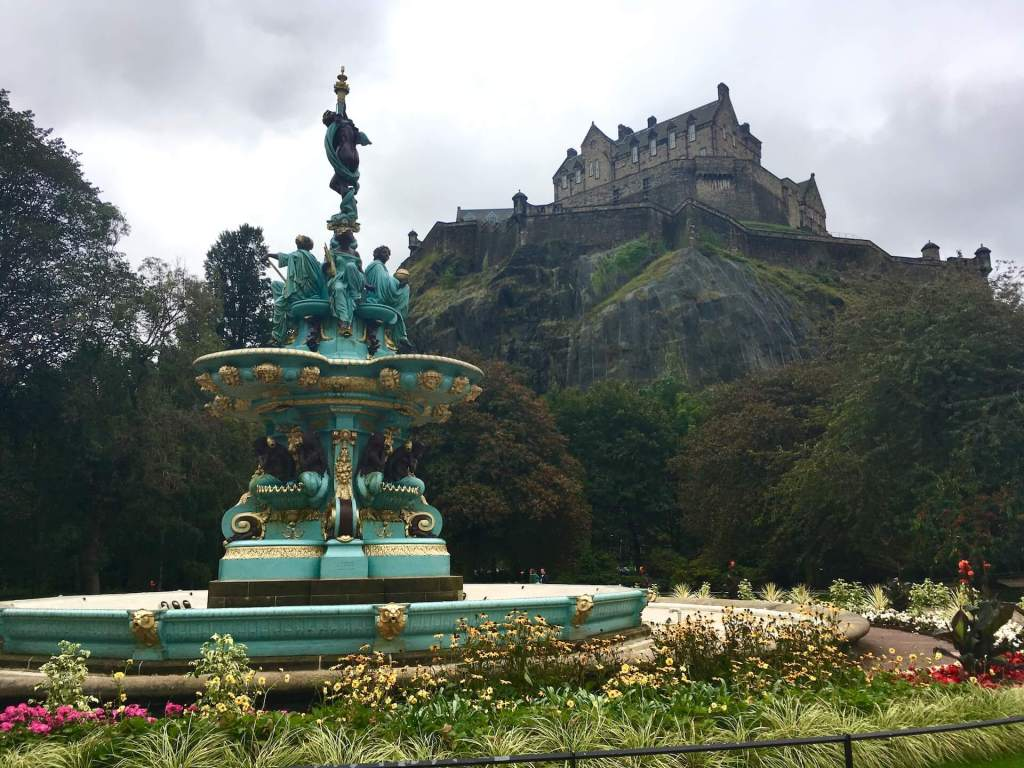 The brightly painted Ross Fountain below Edinburgh Castle