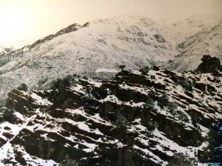 Scattered snow on high mountainside