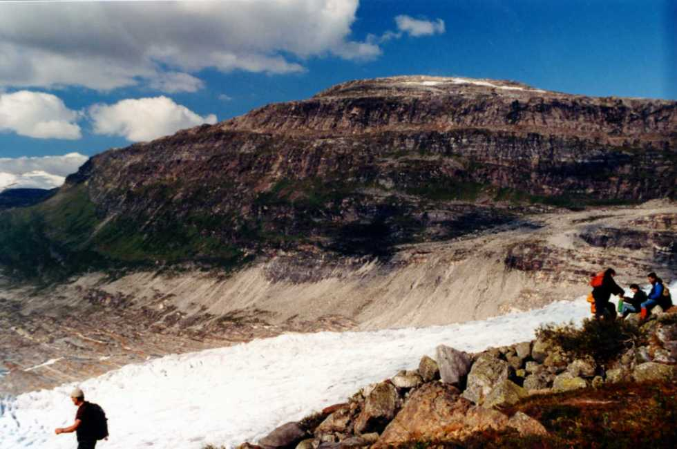 punters-enjoying-a-picnic-and-view-across-the-valley-carved-by-the-glacier-svartisen-norway