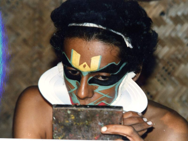 Kathakali performer engaged in make-up. S India