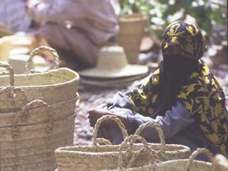 Yemeni woman selling handmade baskets