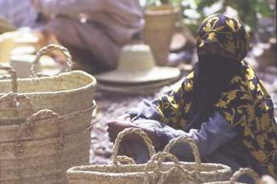 Yemeni woman selling handmade baskets