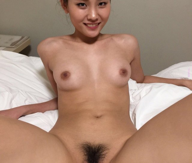 Very Cute Asian Chinese Girl Nude With Her Legs Open On Bed Picture