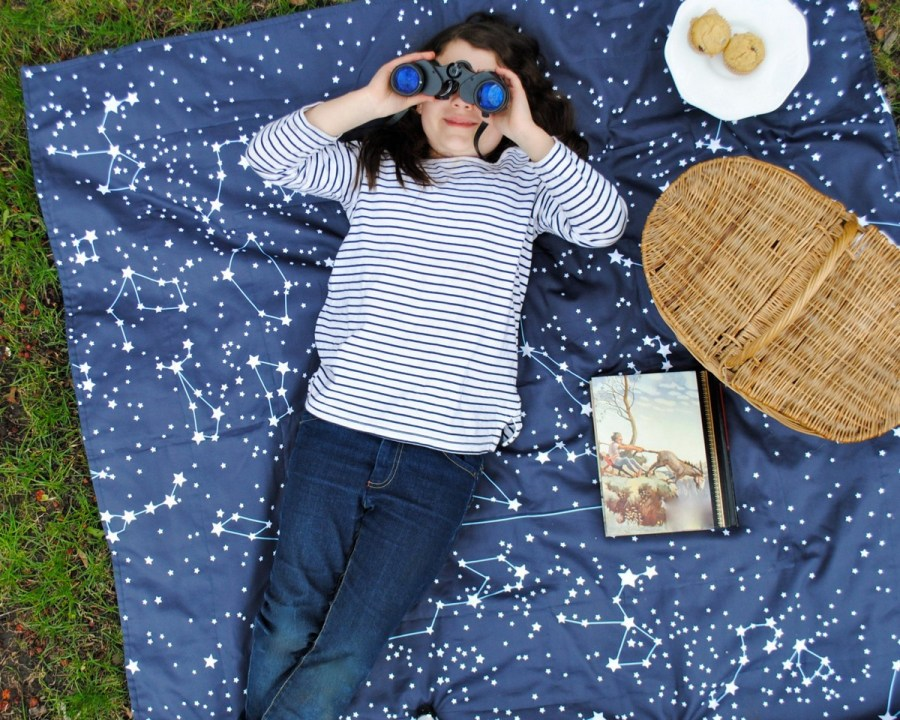 It's the most magical setting and you are drawn outside in a nearby park to have a picnic with your family. Could you possibly think of an afternoon better spent? Don't forget to bring a big picnic blanket!