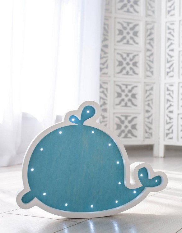 Perfect for setting a calm moon in your kid's bedroom, the Blue Whale Decorative Night Light gives a soft glow when turned on.