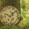 With a sophisticated and functional look, the Honeycomb Wooden Wall Clock will add an element of starry spirit to any room.