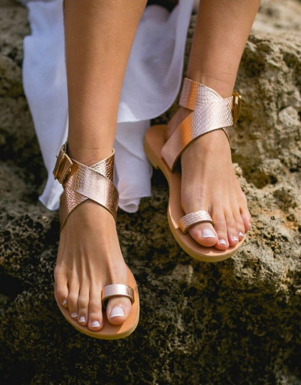 Just what every summer wardrobe needs, the Dione Snake Rose Gold Greek Leather Sandal is every woman's dream pair, super comfy and elegant, and easily combined with any outfit.