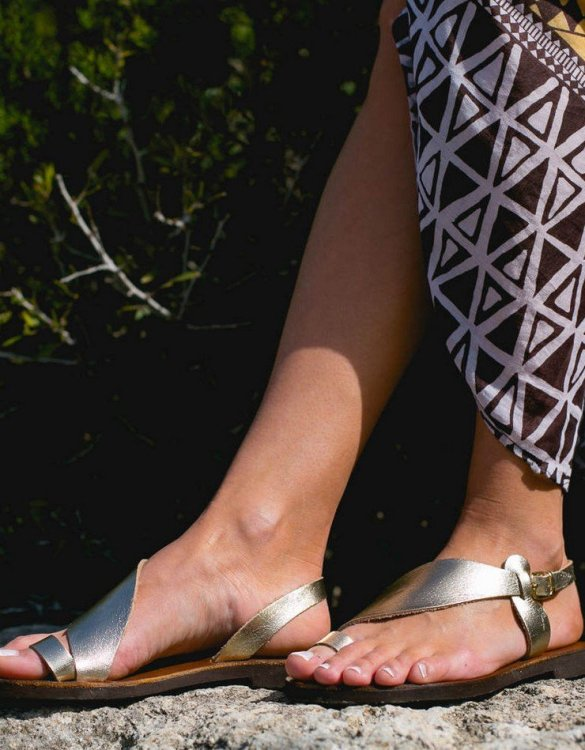Just what every summer wardrobe needs, the Daphne Gold and Brown Greek Leather Sandal is every woman's dream pair, super comfy and elegant, and easily combined with any outfit.