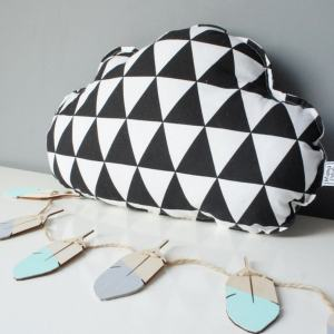 A perfect way to add a touch of magic to a bedroom or nursery, the Small Cloud Black And White Triangles Decorative Pillow would make a wonderful gift for a new baby girl, christening, or naming day and would be the perfect finishing touch for a child's nursery or bedroom.