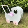 Perfect for taking dolly or teddy for a walk, the Handmade Wooden Doll Pram Heart Mint Pink will parkle your child's imagination and create hours and hours of play! This gorgeous wooden pram is perfect for little girls to take their favourite dolls for a ride, it has rubber wheels and is suited to younger children.