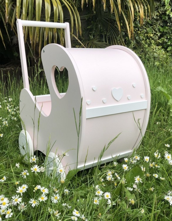 Perfect for taking dolly or teddy for a walk, the Handmade Wooden Doll Pram Heart Pink will parkle your child's imagination and create hours and hours of play! This gorgeous wooden pram is perfect for little girls to take their favourite dolls for a ride, it has rubber wheels and is suited to younger children.