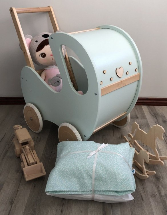 Perfect for taking dolly or teddy for a walk, the Handmade Wooden Doll Pram Mint & Natural Wood Nat Decor will parkle your child's imagination and create hours and hours of play! This gorgeous wooden pram is perfect for little girls to take their favourite dolls for a ride, it has rubber wheels and is suited to younger children.