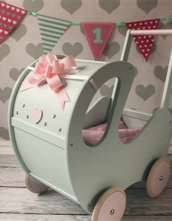 Perfect for taking dolly or teddy for a walk, the Handmade Wooden Doll Pram Mint will parkle your child's imagination and create hours and hours of play! This gorgeous wooden pram is perfect for little girls to take their favourite dolls for a ride, it has rubber wheels and is suited to younger children.