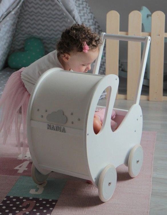 Perfect for taking dolly or teddy for a walk, the Handmade Wooden Doll Pram White & Grey will parkle your child's imagination and create hours and hours of play! This gorgeous wooden pram is perfect for little girls to take their favourite dolls for a ride, it has rubber wheels and is suited to younger children.